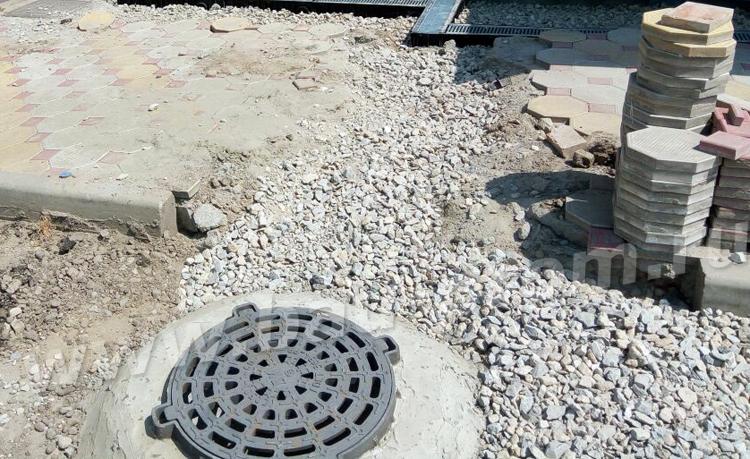 строительство дождеприемного колодца